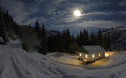 moon-above-a-candle-lit-home